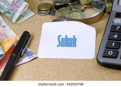 Sukuk word written on white note - Islamic Finance