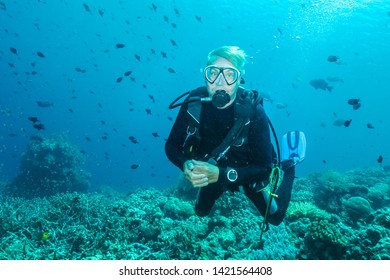 Sulawesi, Indian ocean/ Indonesia - October 19, 2018.  A man scuba dives in beautiful Indian ocean near Sulawesi island . Indonesia
