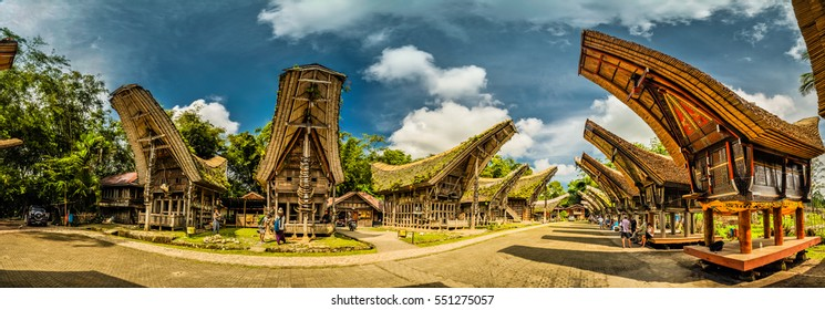 Sulawesi, Indonesia - May 2015: Panoramic photo of tongkonans with saddleback roofs and small square in Kete Kesu, Toraja region in Sulawesi, Indonesia. Documentary editorial.