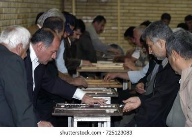 Sulaymaniyah,Iraq - April 04,2006 :Kurdish men playing backgammon