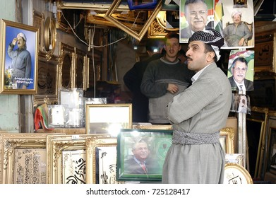 Sulaymaniyah,Iraq - April 04,2006 :The Kurdish man examines pictures in the shop