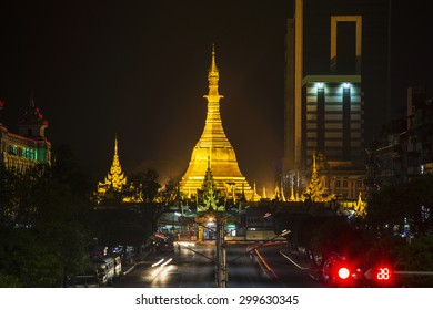 Sule pagoda in night lights, Yangon, Myanmar.  Myanmar (Burma) is the most religious Buddhist country in terms of the proportion of monks in the population and proportion of income spent on religion.