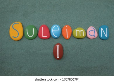 Suleiman I, the tenth and longest-reigning Sultan of the Ottoman Empire from 1520 until his death in 1566 celebrated with a multi colored composition of painted stone letters over green sand