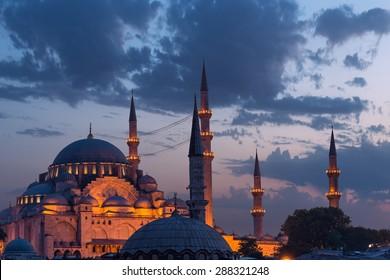 Suleymaniye Mosque lit up at dusk in Istanbul, Turkey.