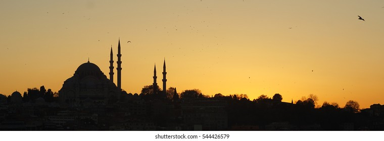suleymaniye mosque silhouette from karakoy at sunset, istanbul, turkey