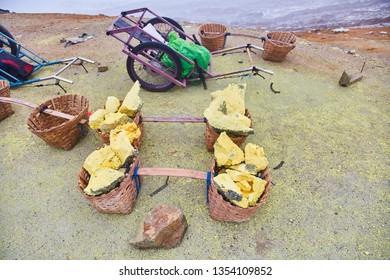 Sulfur in baskets. Volcano Ijen. Sulfur mining. Miners mined sulfur.