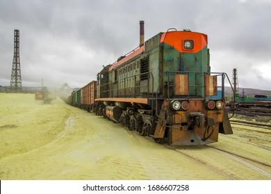 sulfur factory. loading of sulfur in railway cars