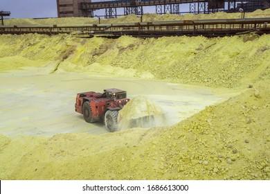 sulfur factory. tractor loading sulfur