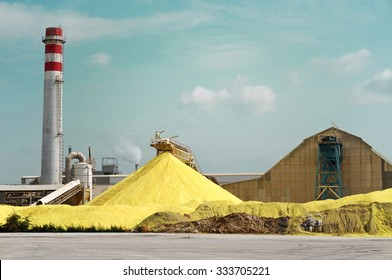 Sulfur Factory / A Yellow Pile of Sulfur Produced in an Industrial Facility