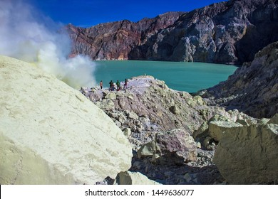 Sulfuric acid lake and gas coming out of the sulphur mines in the crater on the bottom of Mount Ijen active volcano, Banyuwangi, East Java, Indonesia.