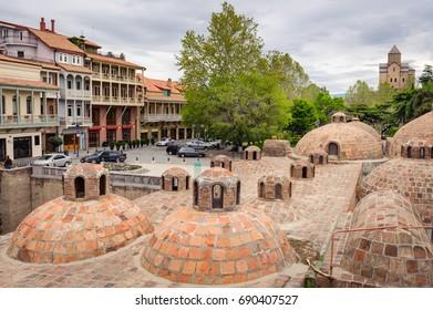 Sulfuric baths in Tbilisi, Georgia. The ancient district Abanotubani with  sulfuric hot thermal baths. Abanotubani is located at the bank of the Mtkvari (Kura) River in Tbilisi, Georgia.