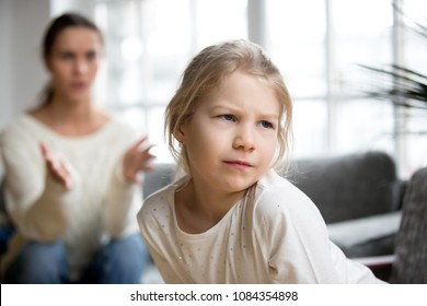 Sulky angry offended kid girl pouting ignoring mother scolding her for bad behavior, stubborn insulted daughter not listening to mom disagreeing with punishment, family conflicts child rebuke concept
