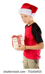 Sulky pre-teen boy with a christmas gift isolated on white background