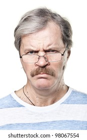 sullen caucasian mature man in glasses isolated on white background