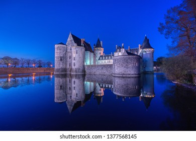 Sully Sur Loire, France - April 13, 2019: Famous medieval castle Sully sur Loire at night, Loire valley, France. The chateau of Sully sur Loire dates from the end of the 14th century.