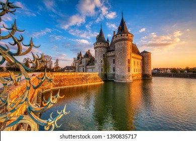 Sully Sur Loire, France - April 13, 2019: Famous medieval castle Sully sur Loire at sunset, Loire valley, France. The chateau dates from the end of the 14th century