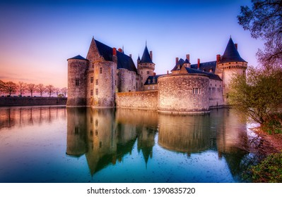 Sully Sur Loire, France - April 13, 2019: Famous medieval castle Sully sur Loire at sunset, Loire valley, France. The chateau Sully sur Loire dates from the end of the 14th century