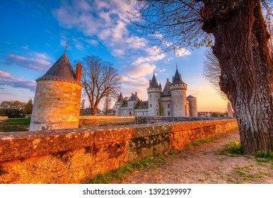 Sully Sur Loire, France - April 13, 2019: Famous medieval castle Sully sur Loire at sunset, Loire valley, France. The chateau dates from the end of the 14th century.