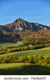 Sulov rock, Slovakia and autumn forest and meadow.