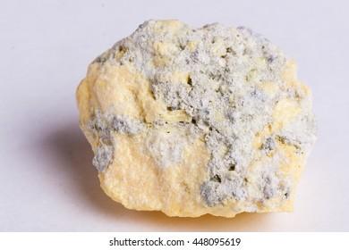 Sulphur crystals on white background