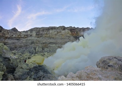 A sulphur miner is seen bringing sulphur up the Ijen Crater amidst the toxic fumes.