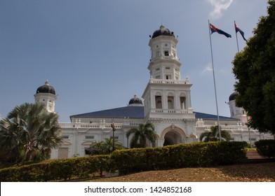 Sultan Abu Bakar State Mosque Building Front Entrance Against Blue Sky in Johor Bahru in Malaysia. The mosque was built between 1892 and 1900 and was named after the ruling Sultan at the time.