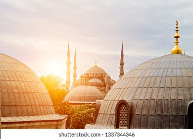 Sultan Ahmet or Blue Mosque landmark, Ottoman ramadan architecture Istanbul, Turkey. Exterior features a cascade of domes and six slender minarets. View from window Hagia Sophia.