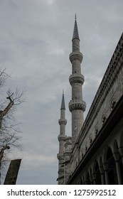 sultan ahmet mosque architectural minarets with gray colored clouds