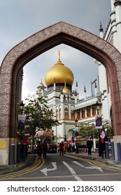 Sultan Mosque/Singapore - 28 Oct 2018: Sultan Mosque (Masjid Sultan) in the Arab Street historic Malay and Arab district, under an arch and dark clouds before a storm