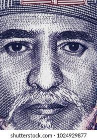 Sultan Qaboos bin Said al Said face portrait on the Oman 1 rial (2015) banknote close up macro, Omani currency closeup