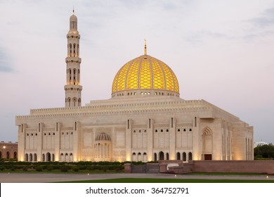 The Sultan Qaboos Grand Mosque illuminated at dusk. Muscat, Oman, Middle East