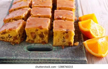 Sultana and orange iced bars on board