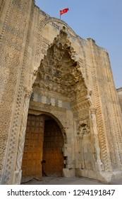 Sultanhani, Aksaray, Turkey - November 7, 2012: Eastern ornamental marble gate entrance or pishtaq of ancient Sultanhani Caravanserai