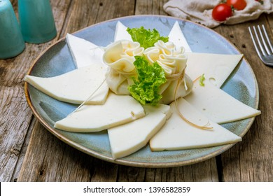 Suluguni cheese sliced on a plate