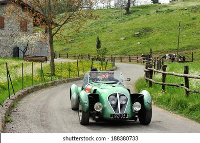 SULZANO, ITALY - APRIL 12: A green Healey Silverstone takes part to the Franciacorta Historic classic car race on April 12, 2014 in Sulzano. This car was built in 1949.
