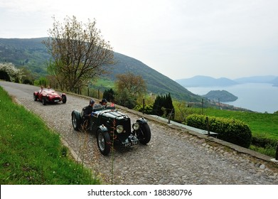 SULZANO, ITALY - APRIL 12: A green Aston Martin MK2, a red Ermini 1100 Sport take part to the Franciacorta Historic classic car race on April 12, 2014 in Sulzano. The car were built in 1935 and 1951.