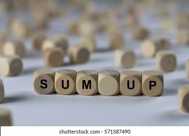 sum up - cube with letters, sign with wooden cubes