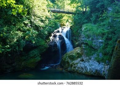 Sum waterfall at the end of Vintgar Gorge in Blejska Dobrava, Slovenia