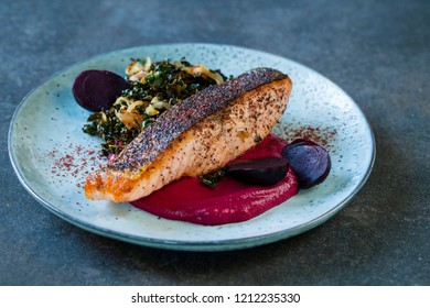 Sumac spiced salmon with beetroot puree and fried kale