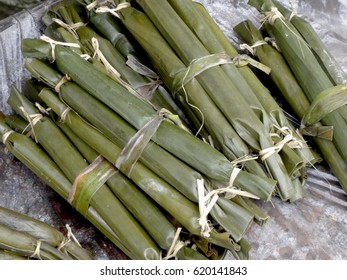 Suman, Filipino favorite. Sticky rice in banana leaves Suman is a Filipino favorite. It is rice cake made from glutinous rice wrapped in banana leaves and cooked in coconut milk.