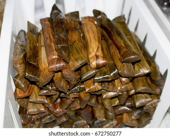 Suman piled inside a plastic bin Suman is a Philippine delicacy made of sticky rice in banana and cooked in coconut milk.