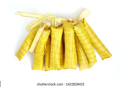Suman sa Ibos, a traditional sticky rice cake wrapped in buli leaves on white background