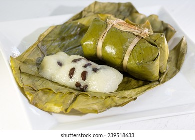 Suman, sticky rice stuffed with bananas, thai dessert