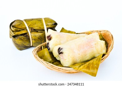 Suman, sticky rice stuffed with bananas, thai dessert isolated on white