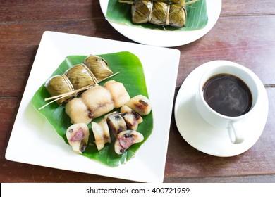 Suman, sticky rice stuffed with bananas, thai dessert, (Thai name  Kao Tom  Mud), Selective focus