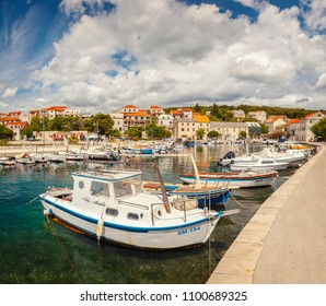 SUMARTIN, CROATIA - MAY 15, 2018. A picturesque ferry port on the island of Brac.
