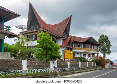 SUMATRA, INDONESIA - JANUARY 22, 2017: View of houses of village Tuktuk on island Samosir, Lake Toba, Sumatra, Indonesia