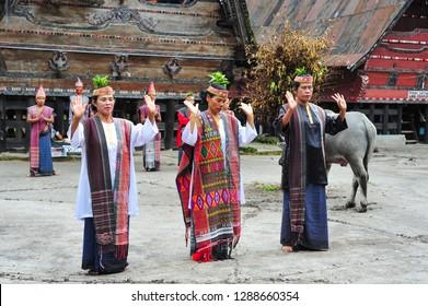 SUMATRA, INDONESIA - MAY 22, 2015: Traditional Batak dancers performing a ceremonial dance in Bolon Simanindo Batak Museum Village
