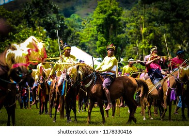 SUMBA, INDONESIA - FEBRUARY 8, 2018: Sumba knight riding a horse in traditional ceremony called Pasola