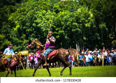 SUMBA, INDONESIA - FEBRUARY 8, 2018: Pasola is traditional games in sumba island. This games is played by brave young knight. They ride a horse and using spear to throw that thing to they enemy.